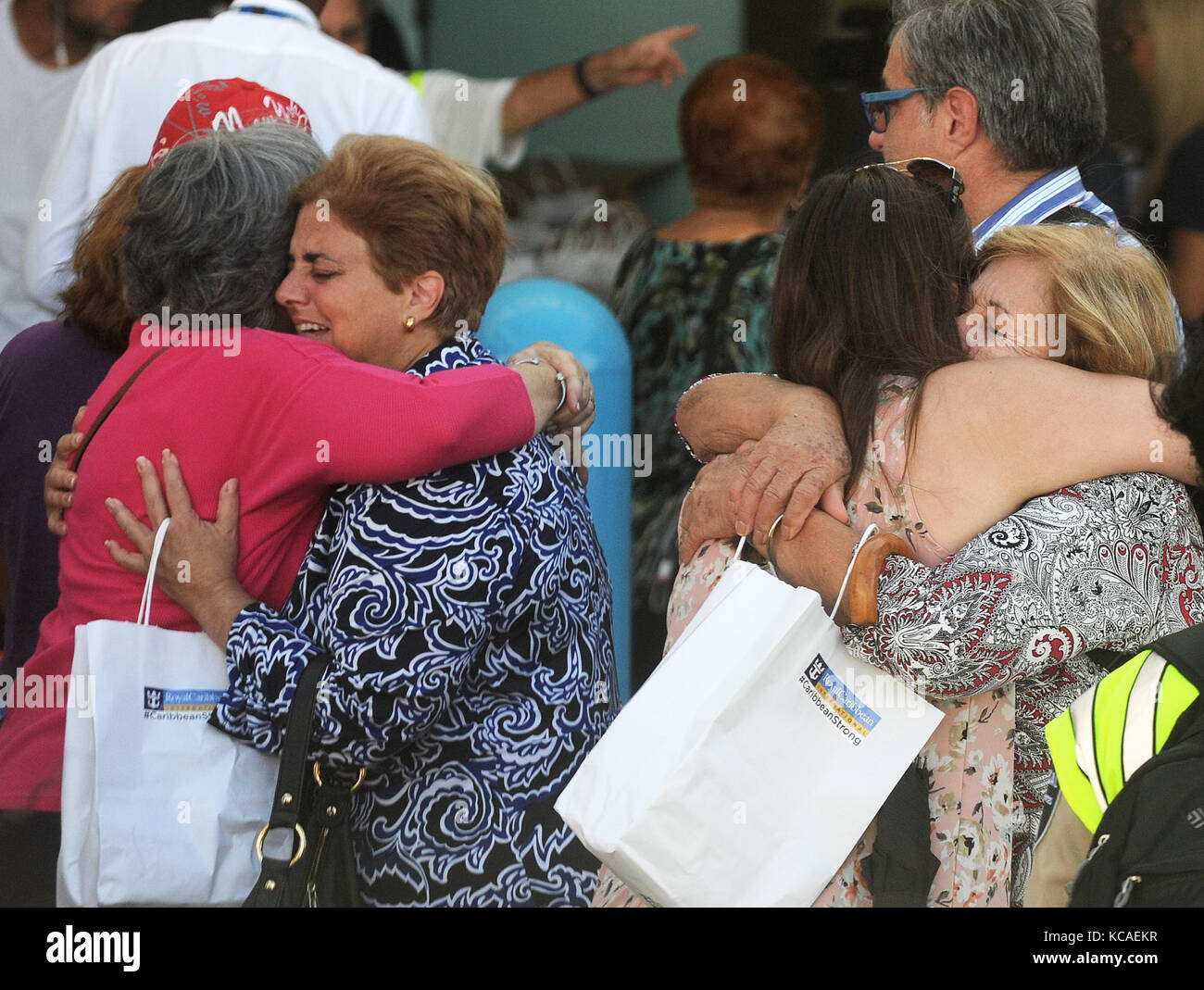 Fort Lauderdale, Florida, USA. 03rd Oct, 2017. Victims of Hurricane Maria embrace with family members at Port Everglades - Stock Image