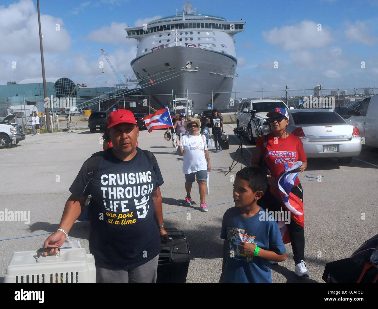 Fort Lauderdale, Florida, USA. 03rd Oct, 2017. The Rivera family, victims of Hurricane Maria, arrive at Port Everglades - Stock Image