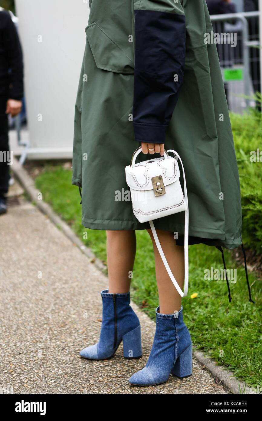 98f1bf60d978 Blogger Irene Kim posing outside of the Sacai runway show during Paris  Fashion Week - Oct