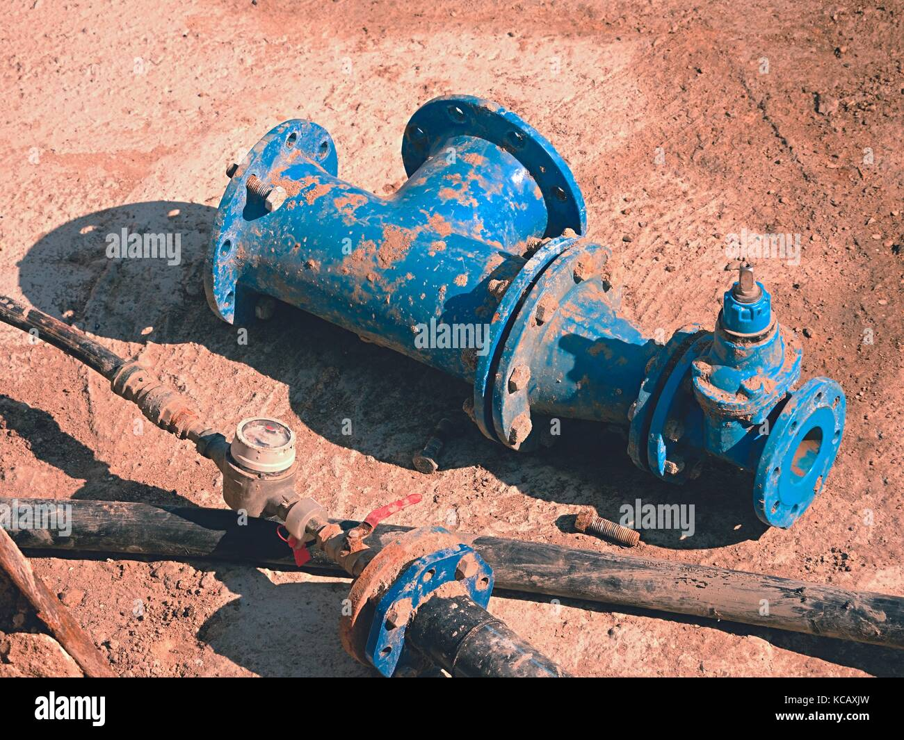 Old drink water pipes, used blue gate valve and reduction joint members. Water supply interrupted, repairing of - Stock Image
