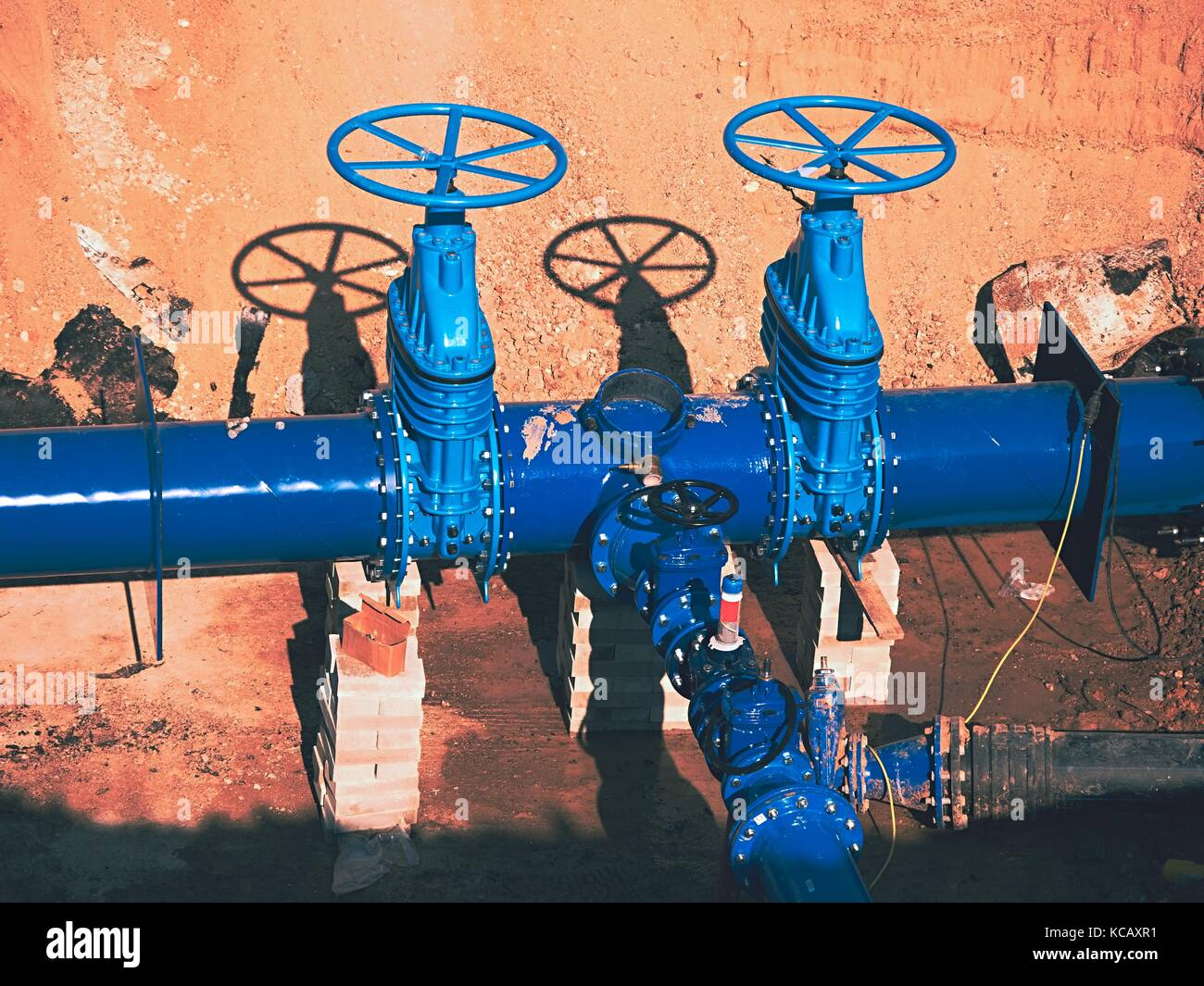 Construction of main City water supply pipeline. 500mm large water pipeline with gate valves, 250mm branch.   Pipes - Stock Image