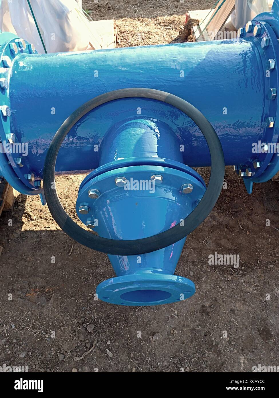 500mm  drink water pipe  joint with reduction member to 150 mm unit by screws and nuts. Pipe fitting, rubber plastic - Stock Image
