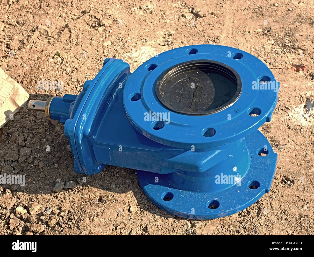 Detail of fittings, 150mm gate valves for drink water system. Repairing of piping in excavation pit. New blue painted - Stock Image