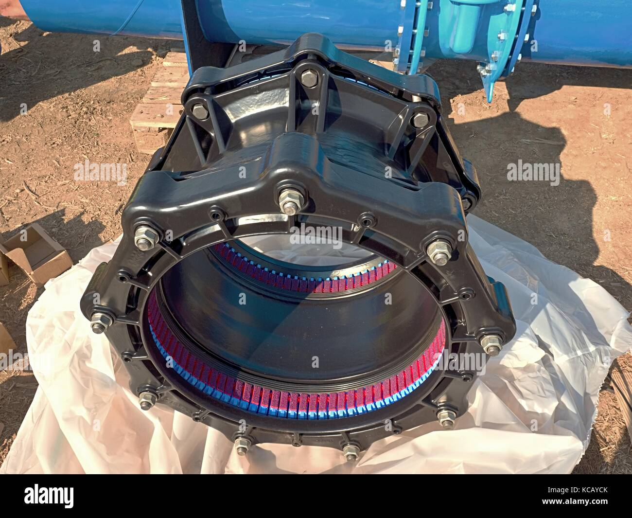 500mm new black waga multi joint members. New spare parts for repairing of  piping in paper cover. Drink water pipeline. - Stock Image