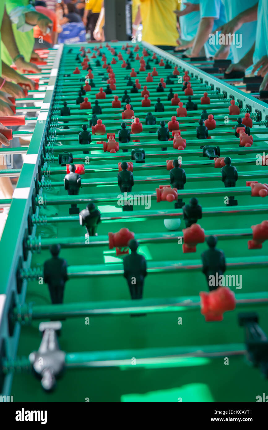 Very Long Table Football Game for Fifty Players Simultaneously - Stock Image