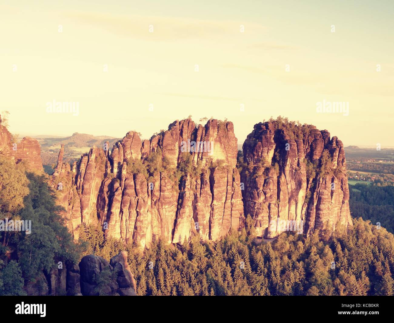 Morning sunlight on rocky towers of Schrammsteine in national park Saxony Switzerland, Germany. Popular climbers - Stock Image