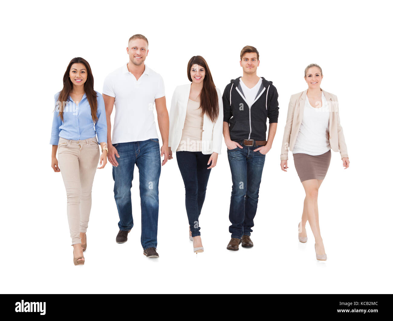 A Group Of Multi Ethnic People Walking On White Background - Stock Image