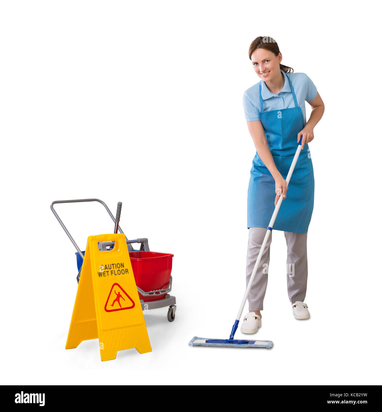 Young Female Janitor Cleaning Floor Using Mop On White Background Stock Photo