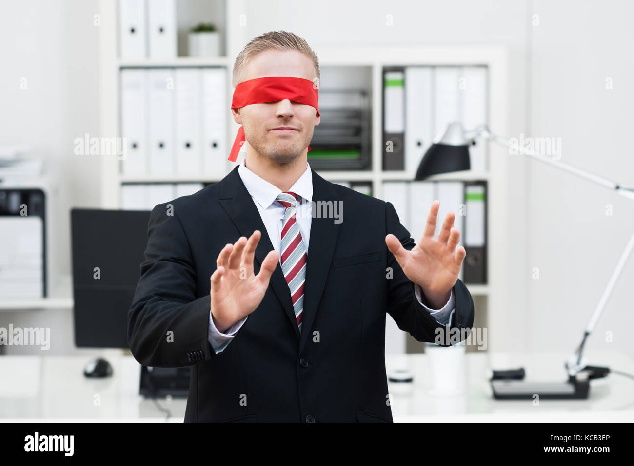 2958ac8b58c Portrait Of A Blindfolded Young Businessman Gesturing In Office - Stock  Image