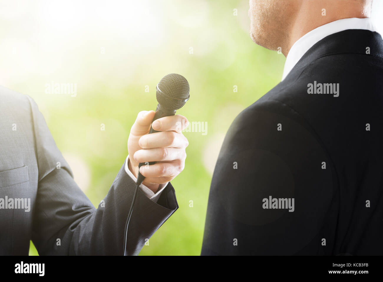 Close-up Of A Reporter Conducting Interview Of Businessman - Stock Image