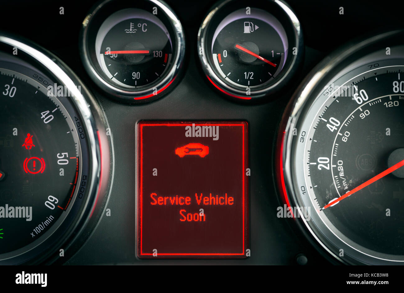 Service car warning light on a car dashboard - Stock Image