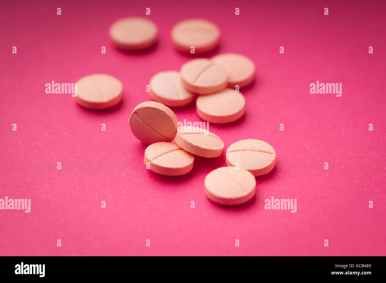 Background of color pills for use in graphic design in medical applications, brochures, presentations and publications. Stock Photo