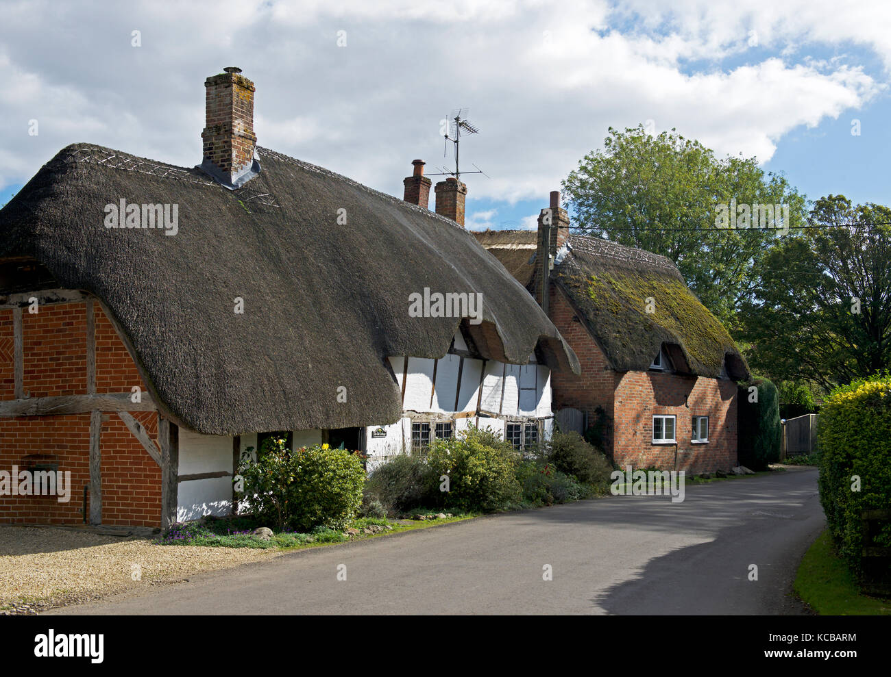 Thatched cottages in the village of East Garston, Berkshire, England UK - Stock Image