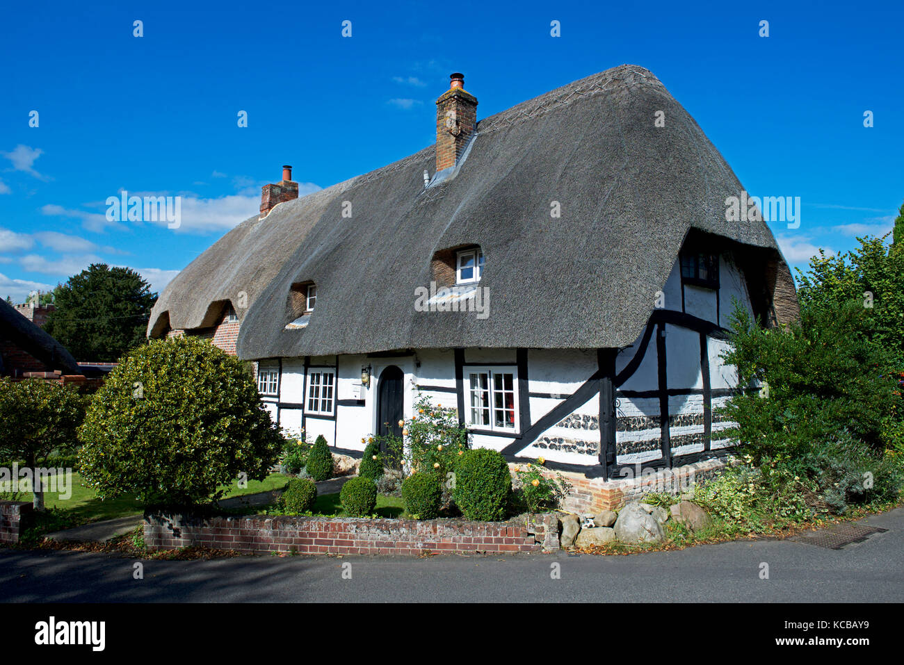 Thatched cottage in the village of Boxford, Berkshire, England UK - Stock Image