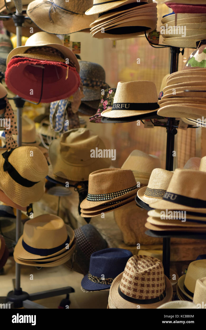2f7c4e6e a selection of hats for sale at a tourists or visitors souvenir shop in  kassiopi on the greek island of corfu. Selling head gear for shade and cool.
