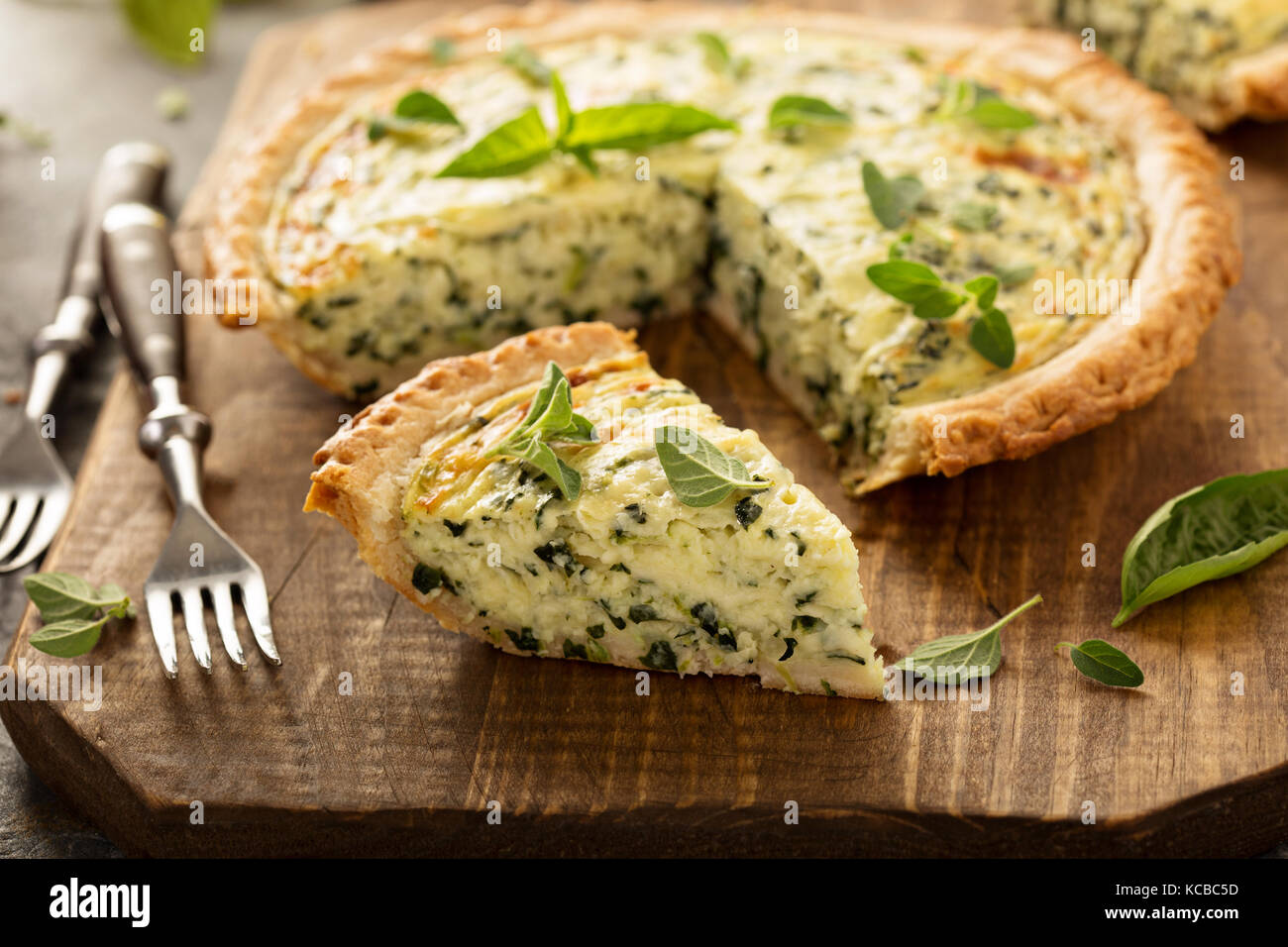 Spinach and herb Florentine quiche - Stock Image