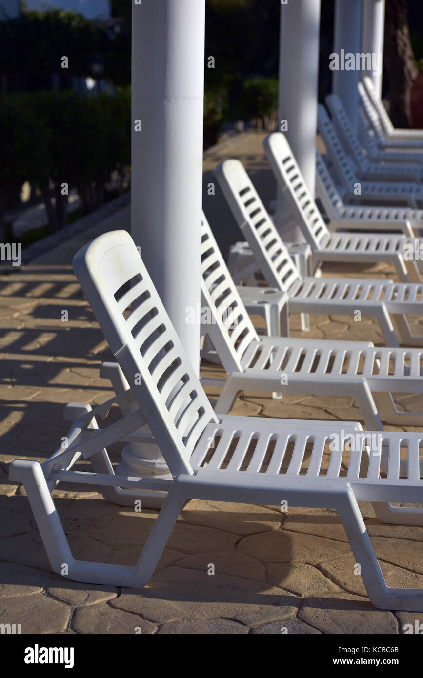 sun loungers next to a pool in Greece at a hotel. - Stock Image