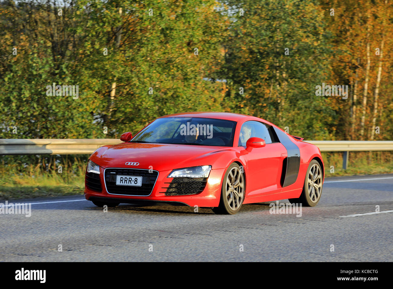 JYVASKYLA, FINLAND - SEPTEMBER 23, 2017: Beautiful Red Audi R8 at speed on highway in autumn. - Stock Image