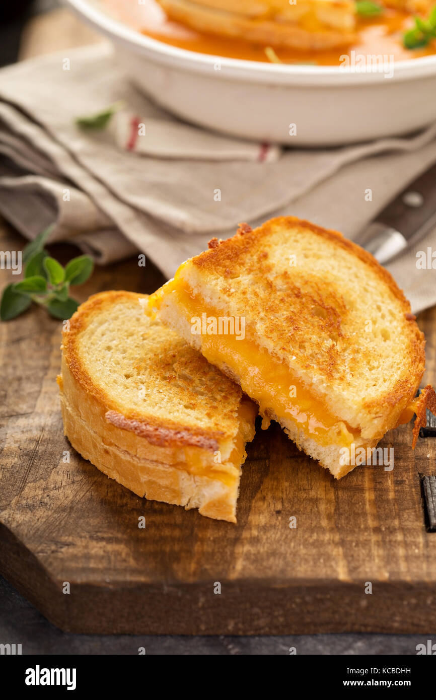 Grilled cheese sandwiches with white bread and cheddar - Stock Image