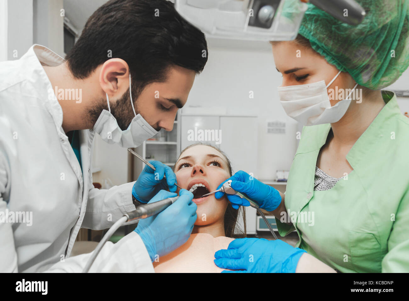 Young talented dentist and nurse at work - Stock Image