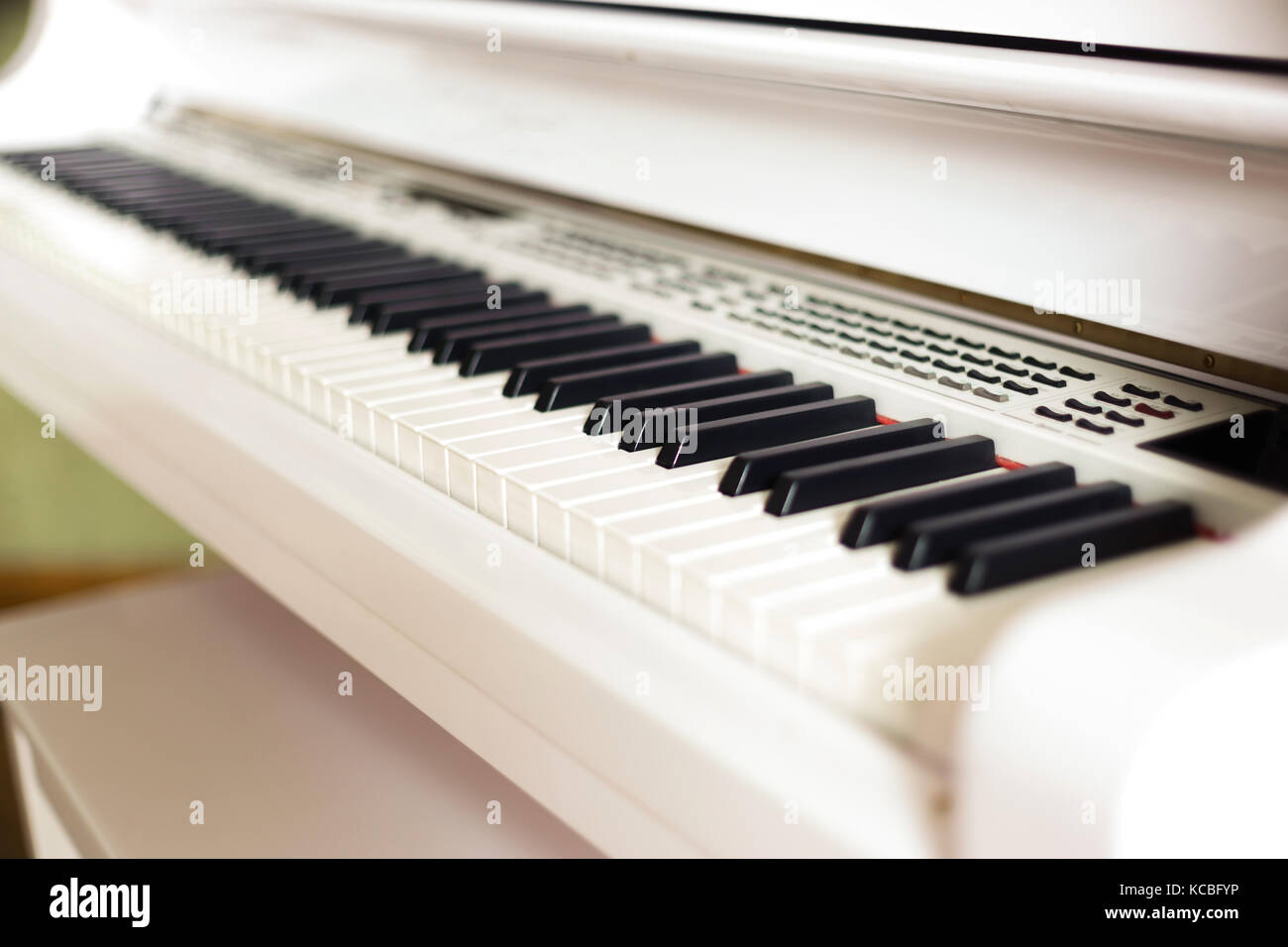 background of electronic grand piano keyboard, close up - Stock Image