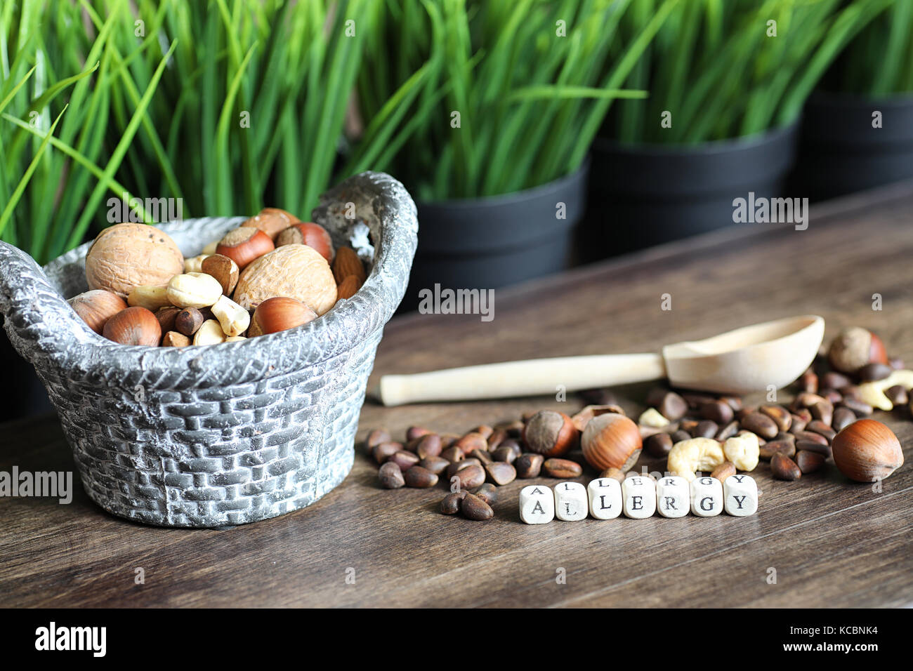 tasty nuts on a wooden table - Stock Image