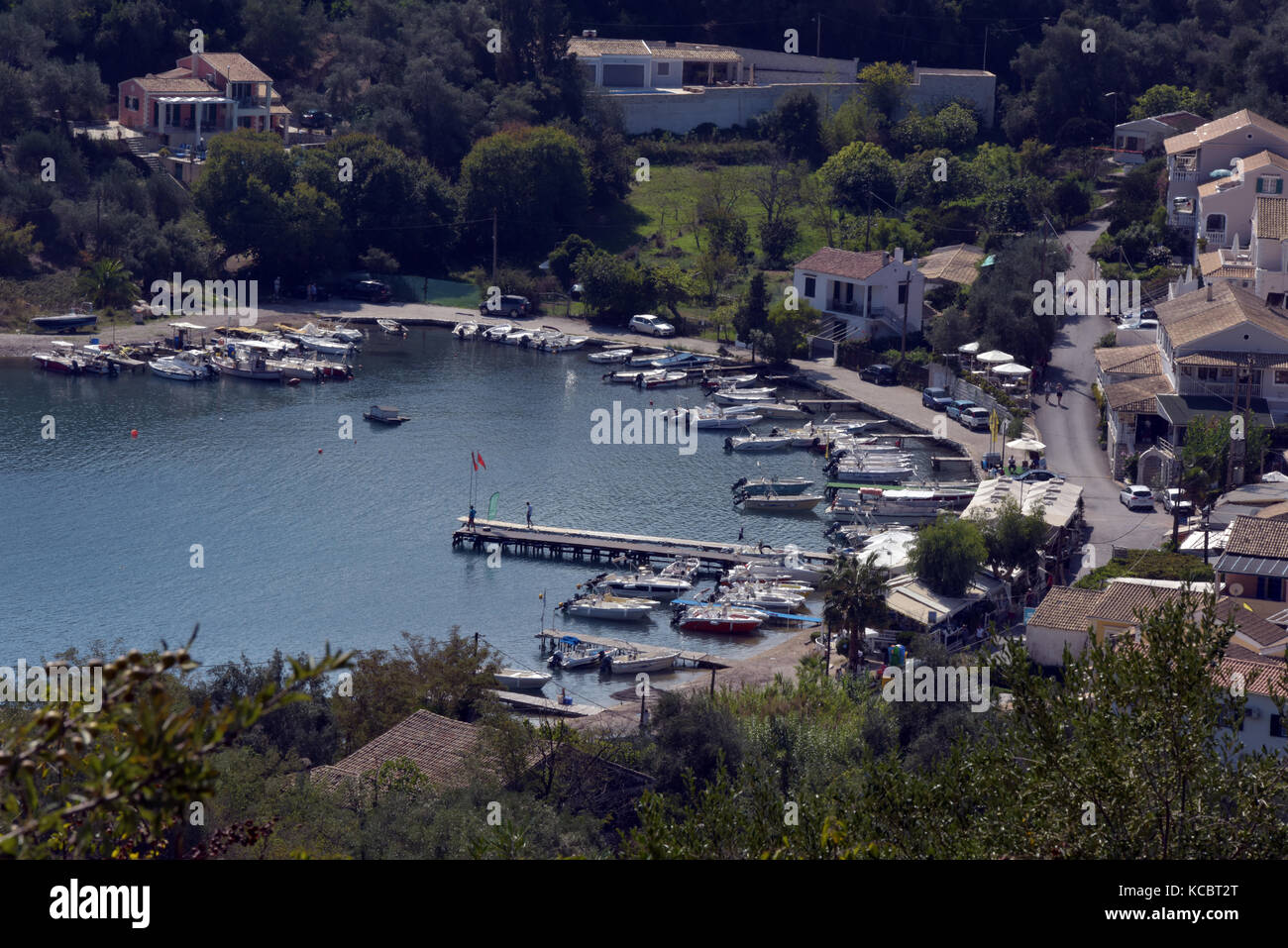 The beautiful, picturesque and scenic harbour and bay at Saint Stefanos near kassiopi on the greek island of Corfu Stock Photo