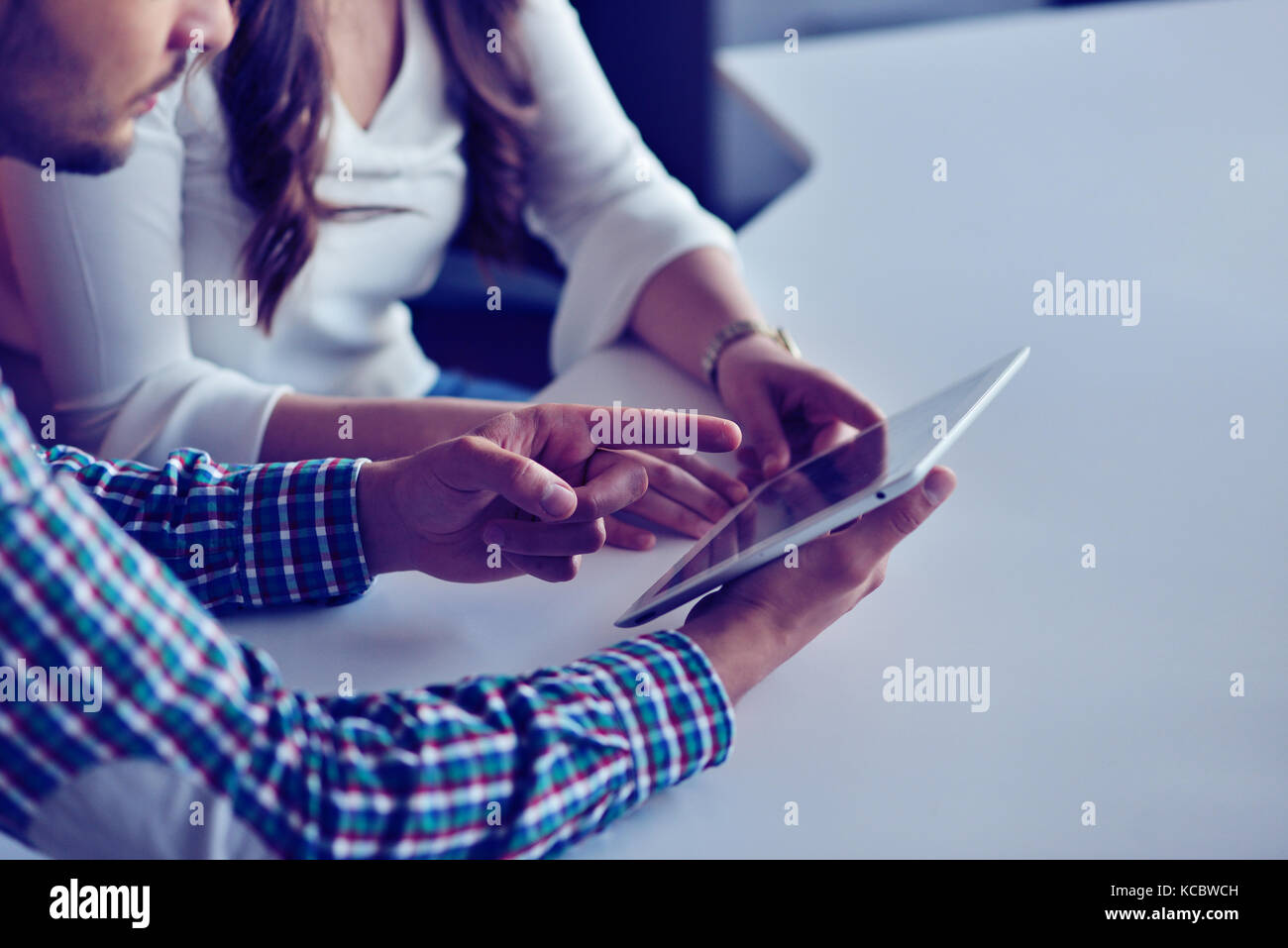 Coworkers work modern studio.Production managers team working new project.Young business crew discussion startup. - Stock Image