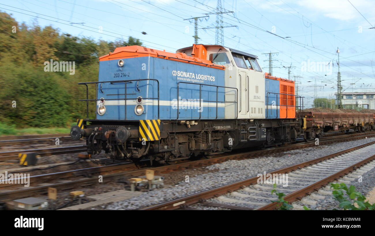 DB Class V 100 diesel locomotive operated by Sonata Invest with mixed manifest freight train at Gremberg, Cologne, - Stock Image