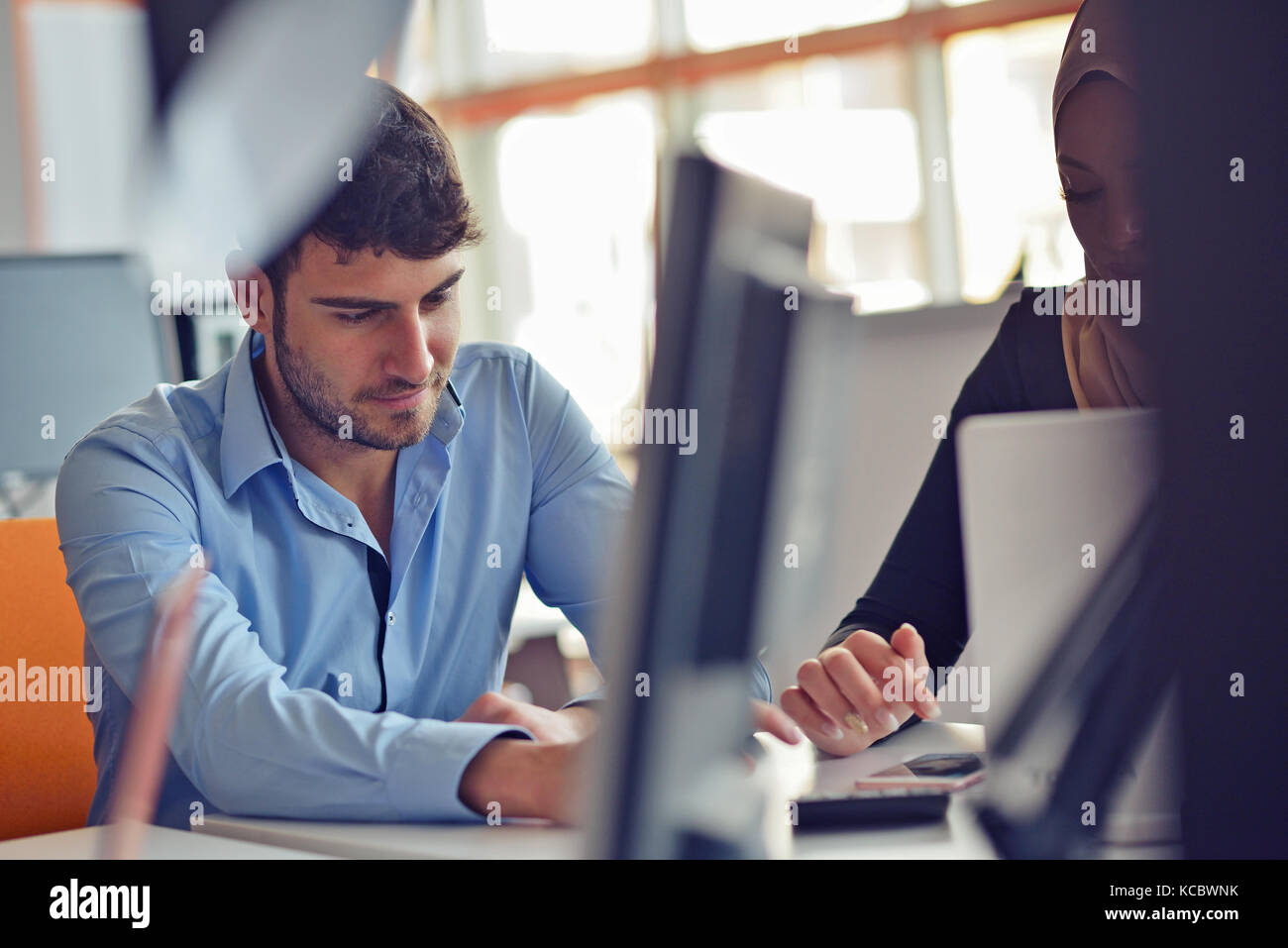 Freelance programmer working in startup office - Stock Image