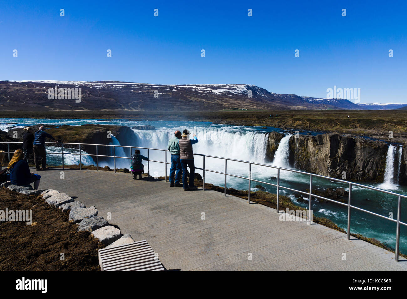 Tourists at viewpoint for Goðafoss waterfall, Iceland - Stock Image