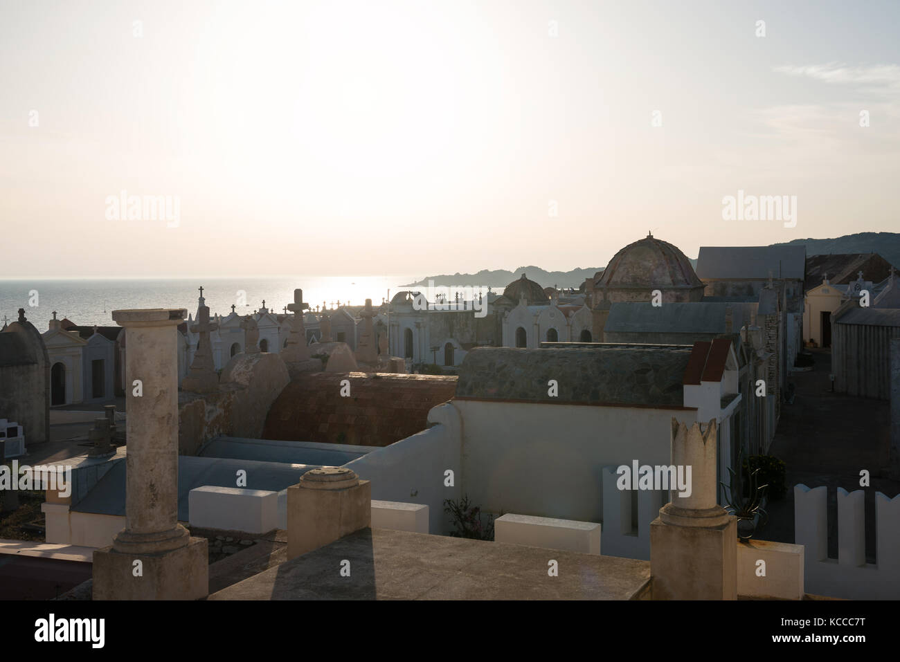 Sun sets behind tombs of marine cemetery in Bonifacio, Corsica Island, France - Stock Image