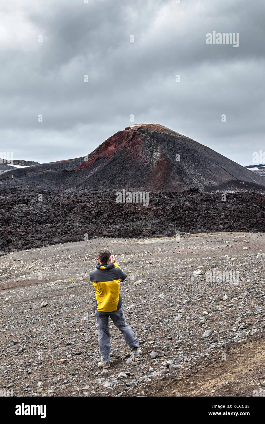 Photographer Photographing the Initial Eruption Site of the Eyjafjallajokull Volcano in the Fimmvorouhals Pass with - Stock Image