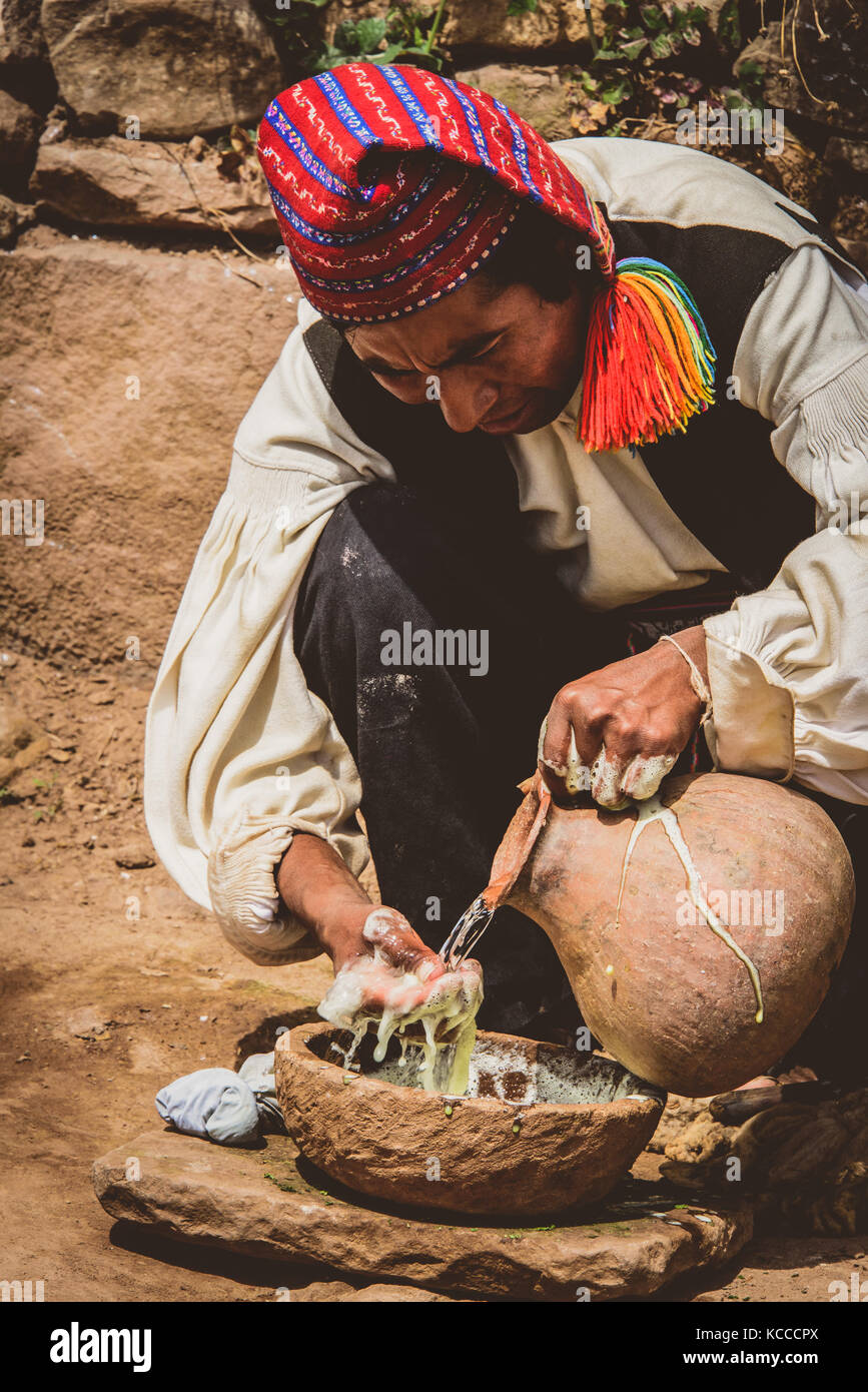 Peruvian man making soap with traditional methods - Stock Image