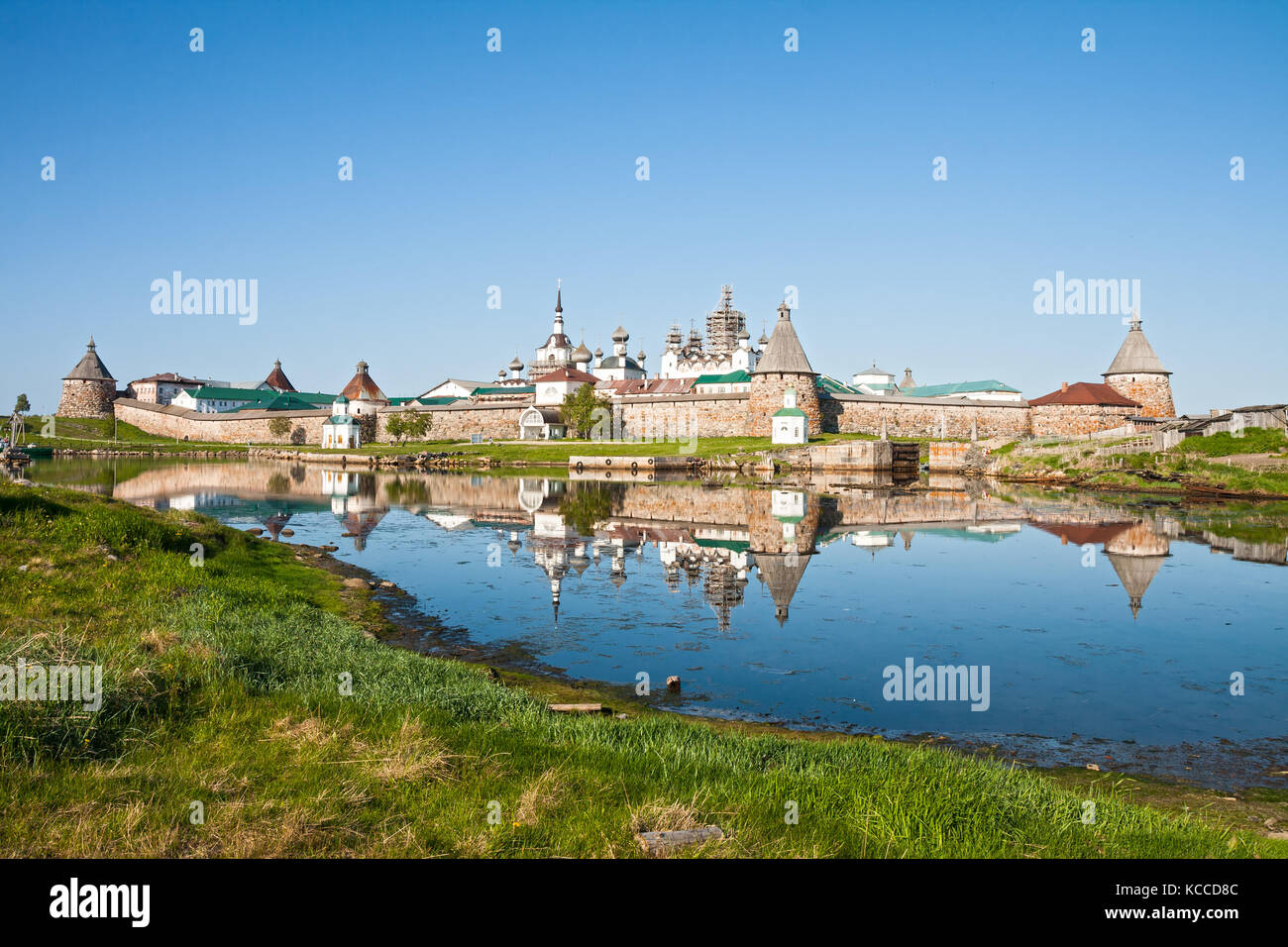View on Solovetsky Monastery with reflection in water, Russia Stock Photo