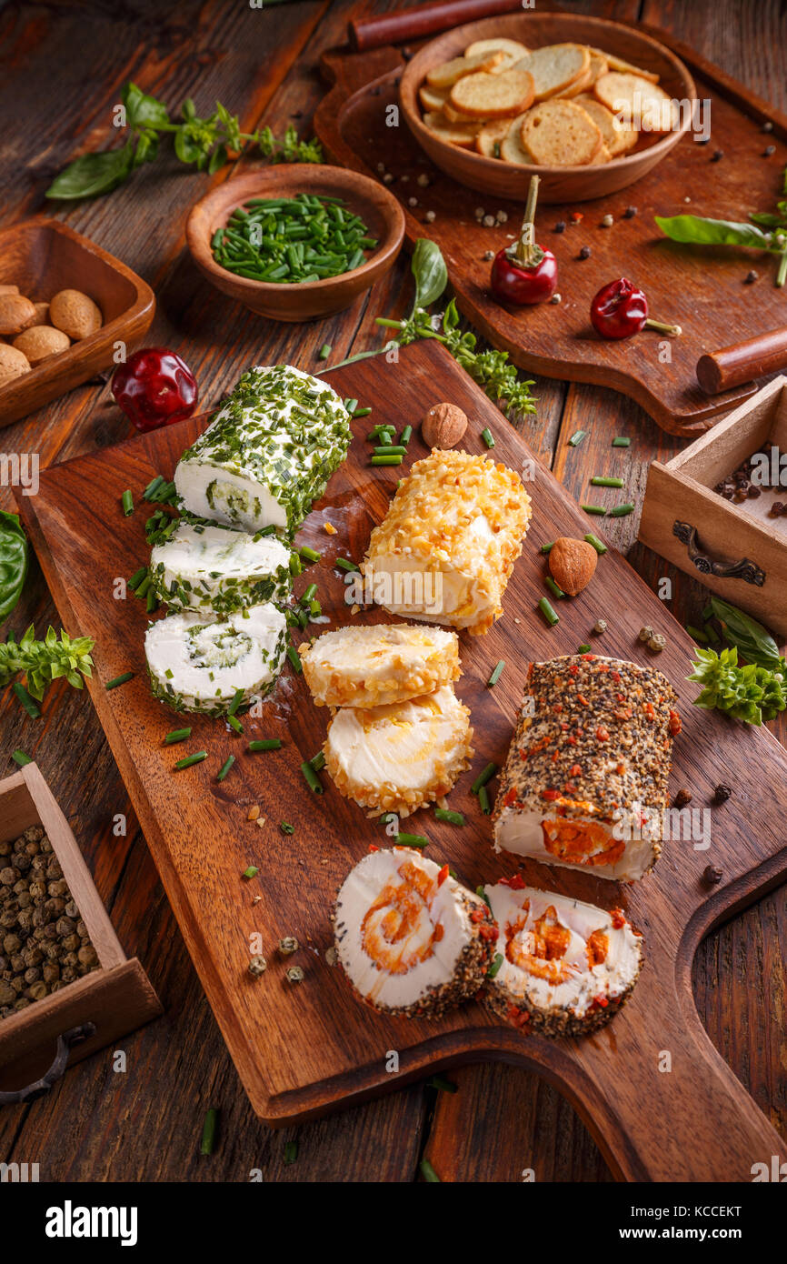 3 mini cheese appetizers covered with spices and chive pieces - Stock Image