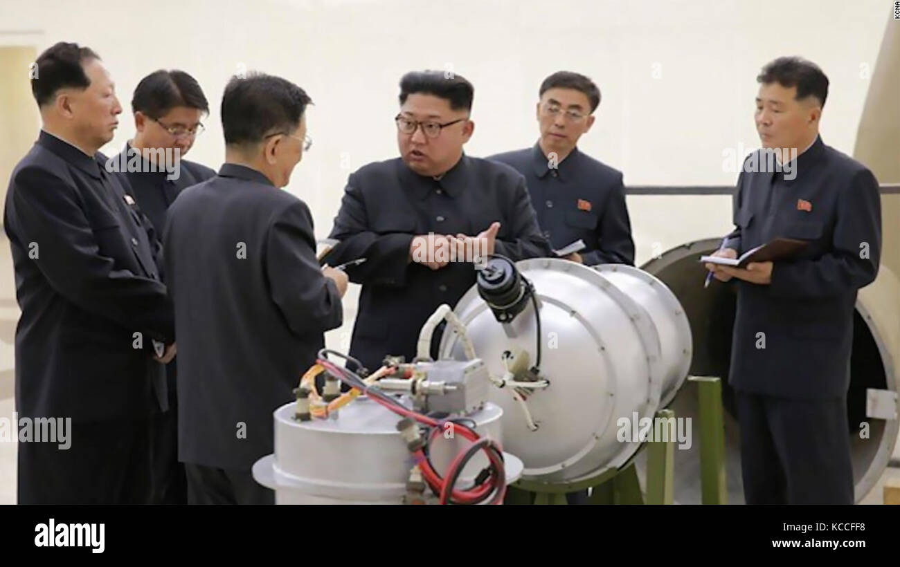 KIM JONG-UN leader of North Korea inspects what is claimed to be a hydrogen bomb capable of being fitted to a ballistic - Stock Image