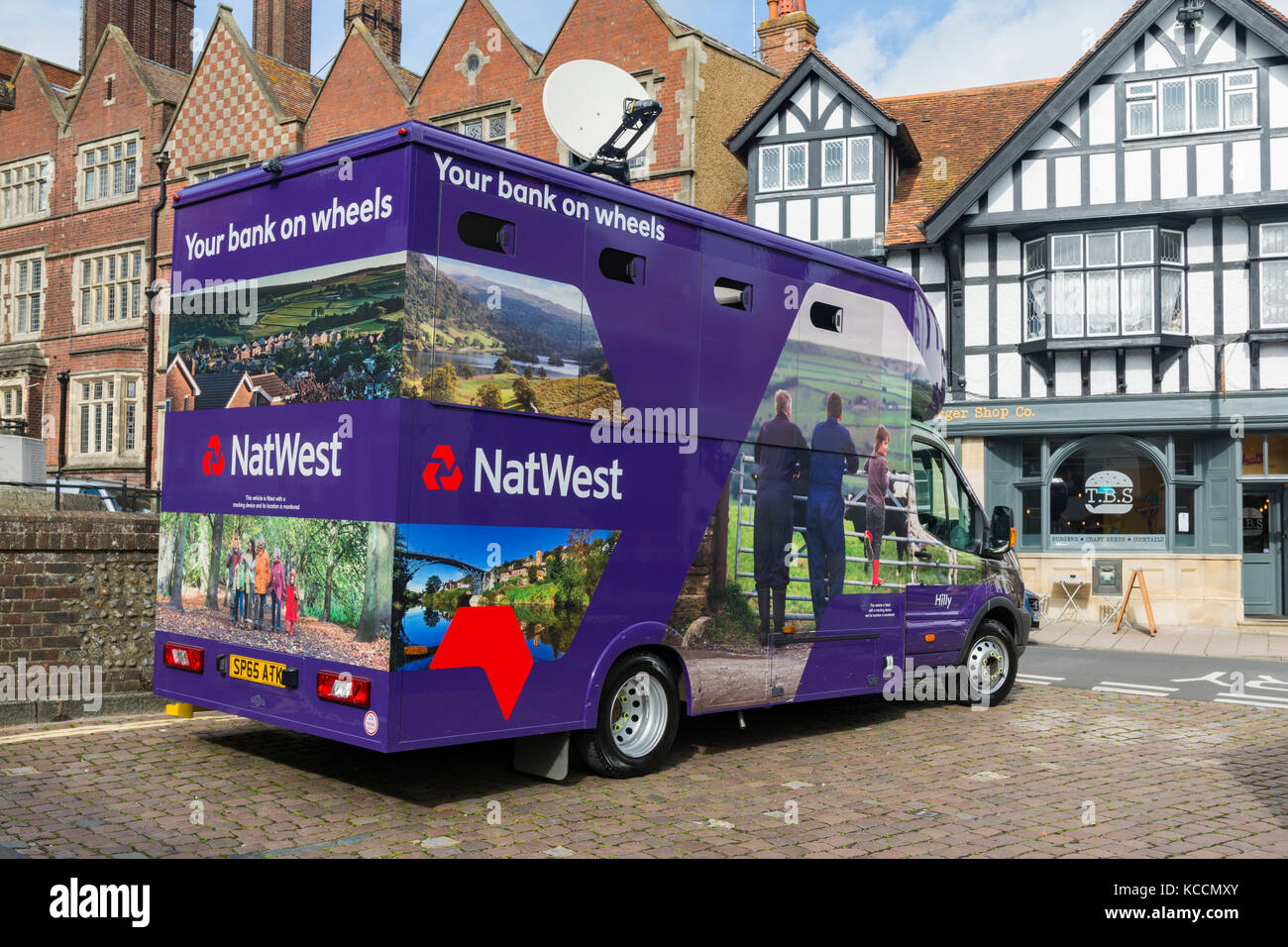 NetWest bank on wheels van for mobile banking in Arundel, West Sussex, England, UK. - Stock Image