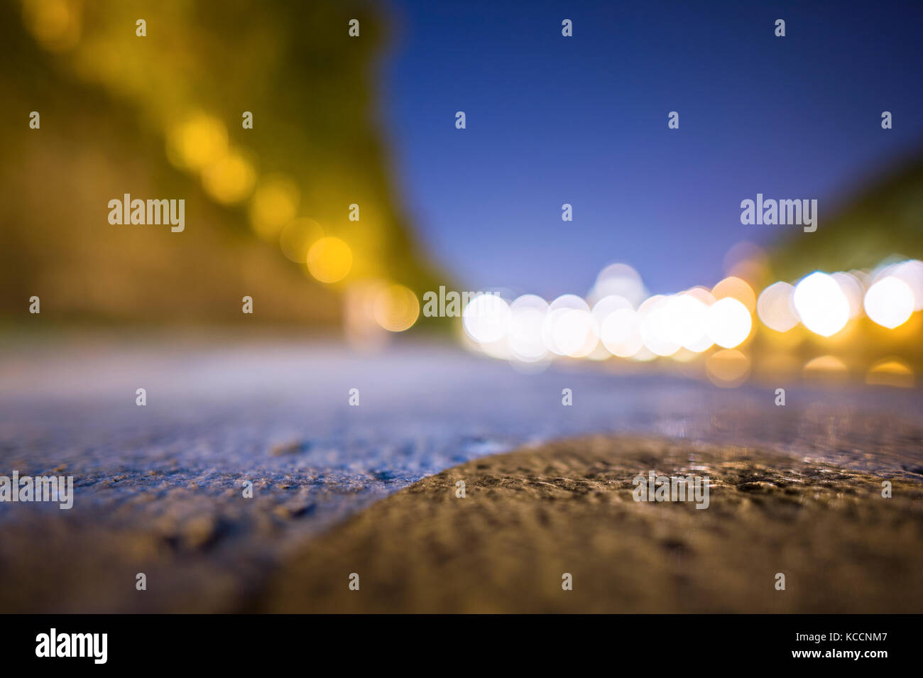 (selective focus, blurred) Blurred nightscape of the Saint Peter Basilica. Photo taken on the banks of the Tiber - Stock Image