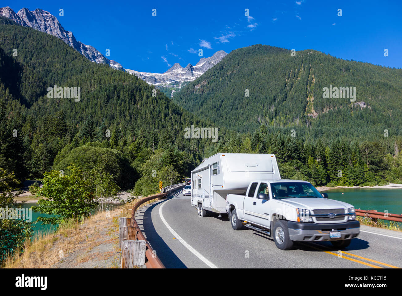 Truck with camping trailer on North Cascades Highway Route 20 in North Cascades National Park in Northwest Washington Stock Photo