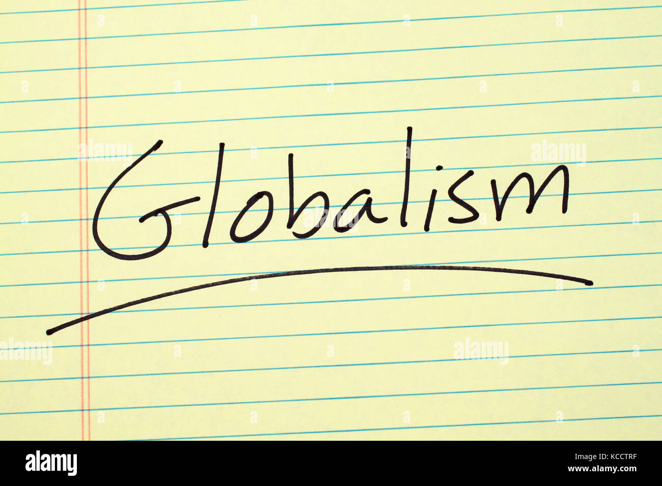 The word 'Globalism' underlined on a yellow legal pad - Stock Image