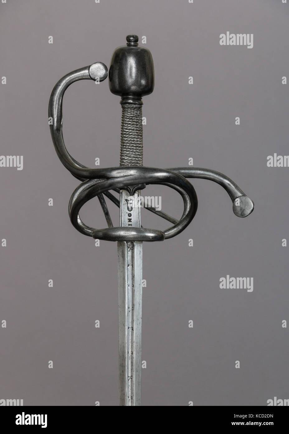 Rapier, late 16th century, Milan, hilt, probably German; blade, Italian, Milan, Steel, wood, iron, L. 45 5/8 in. - Stock Image