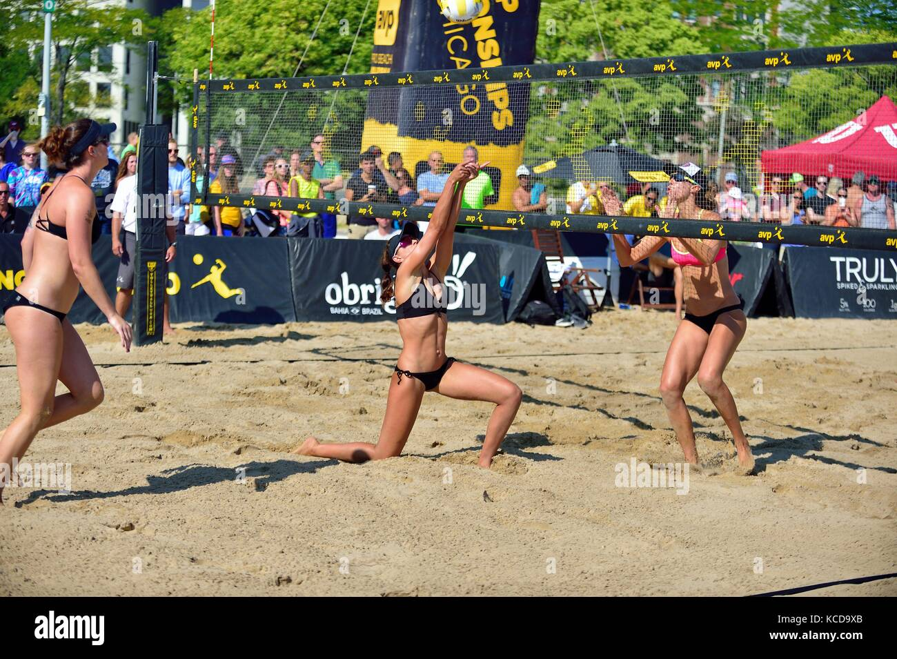 Player setting for a kill shot for her partner during the quarter finals at the AVP 2017 Women's Chicago Championships. - Stock Image