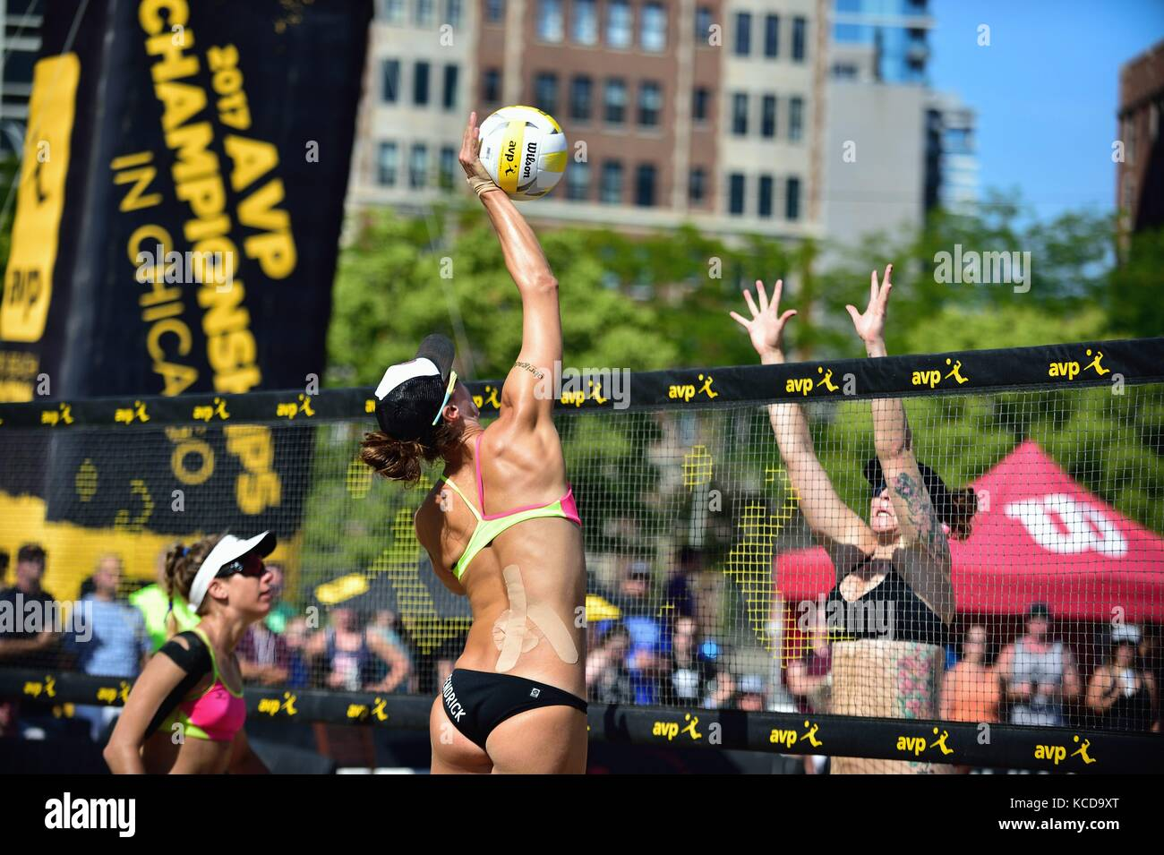 Player delivering a kill shot at the net during quarter final action at the AVP 2017 Women's Chicago Championships. - Stock Image