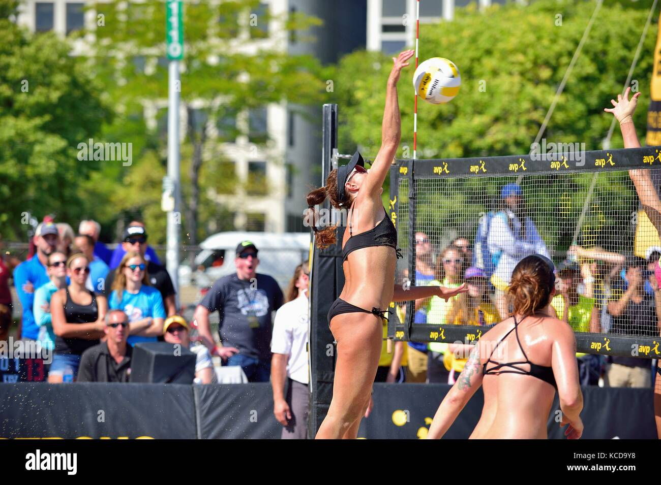 Player delivering a kill shot at the net during the quarter final action at the AVP 2017 Women's Chicago Championships - Stock Image