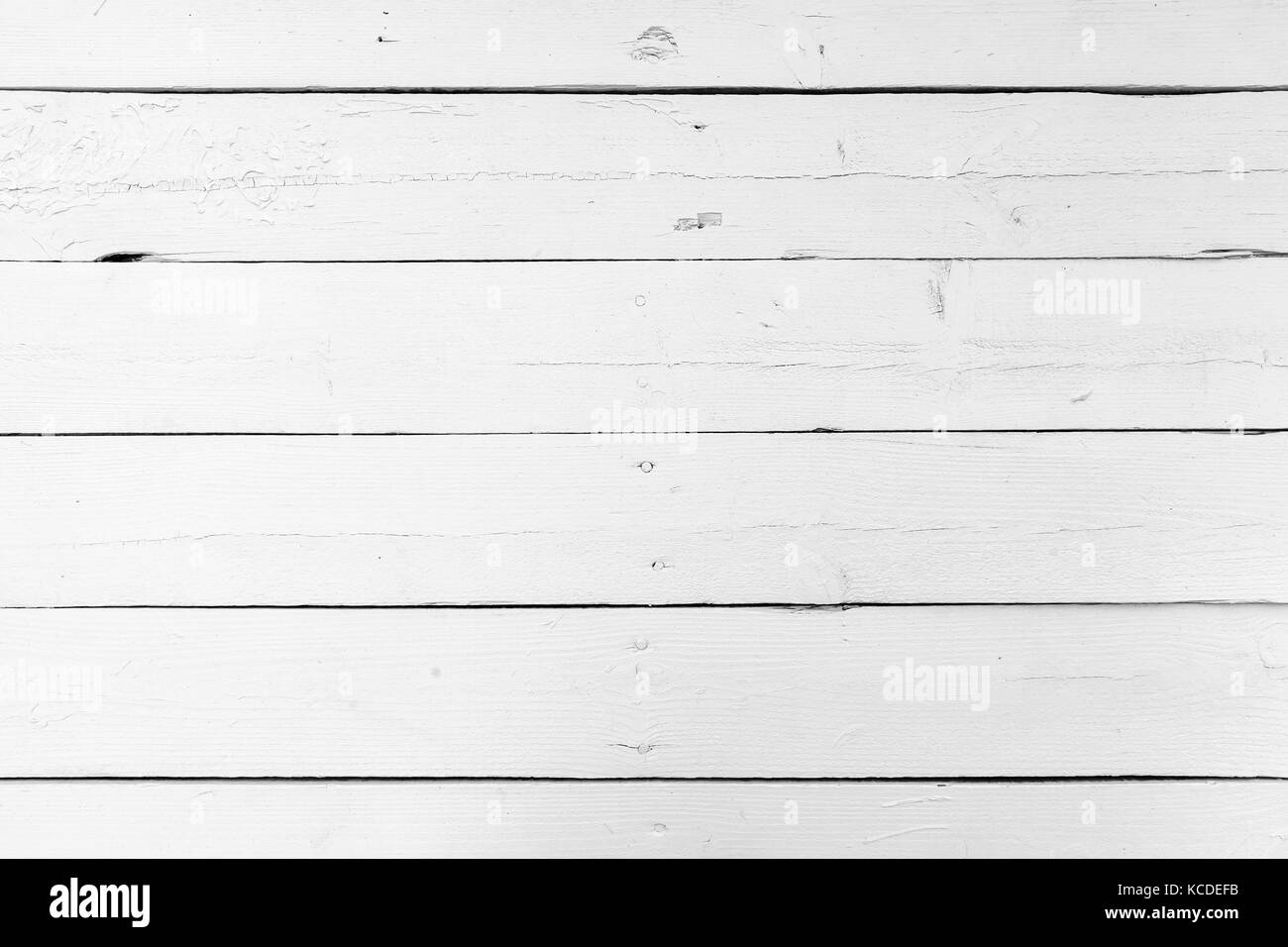 Natural white wooden wall made of planks connected with nails, background photo texture - Stock Image