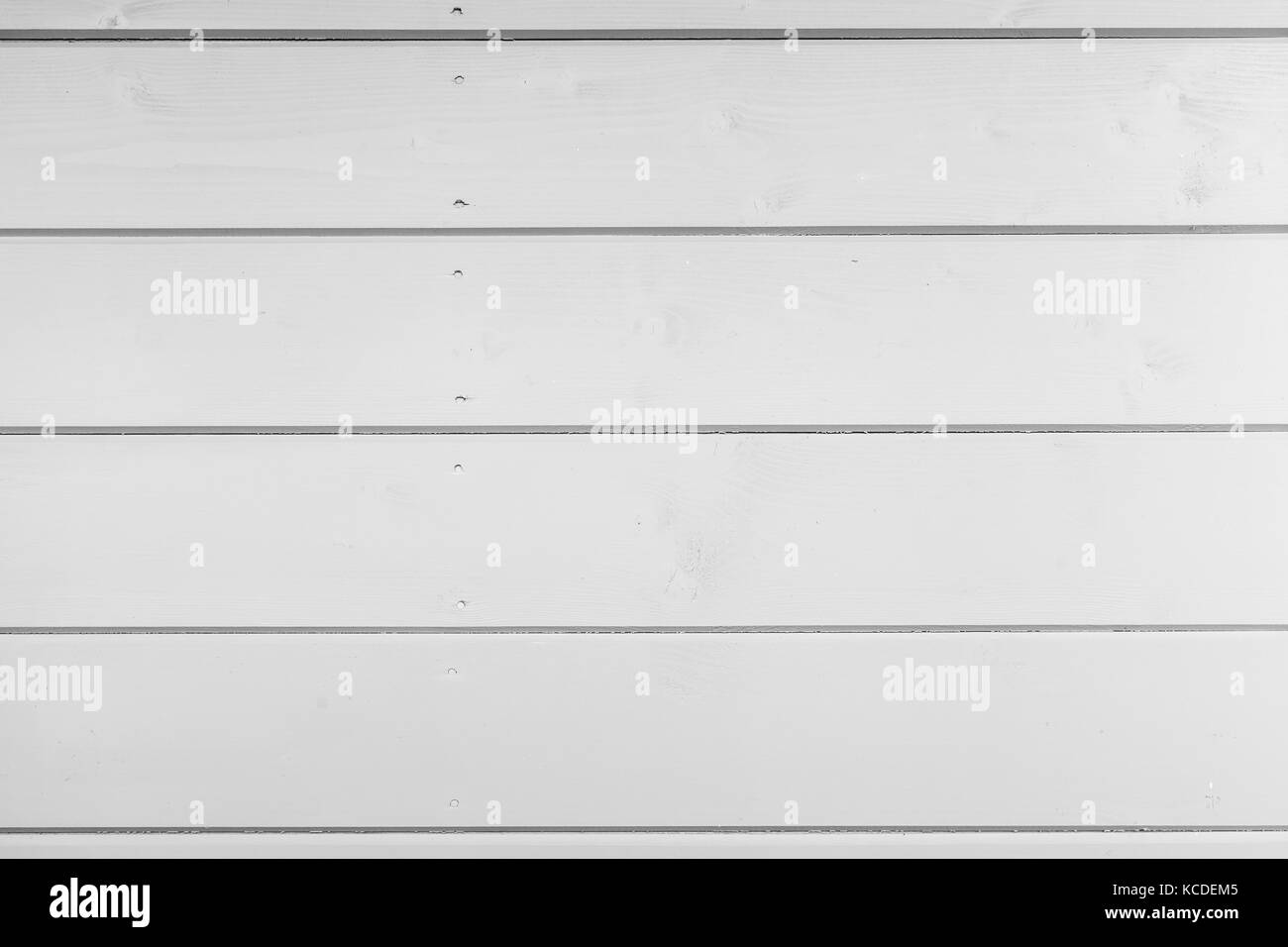 Natural white wooden wall, frontal view, background photo texture - Stock Image