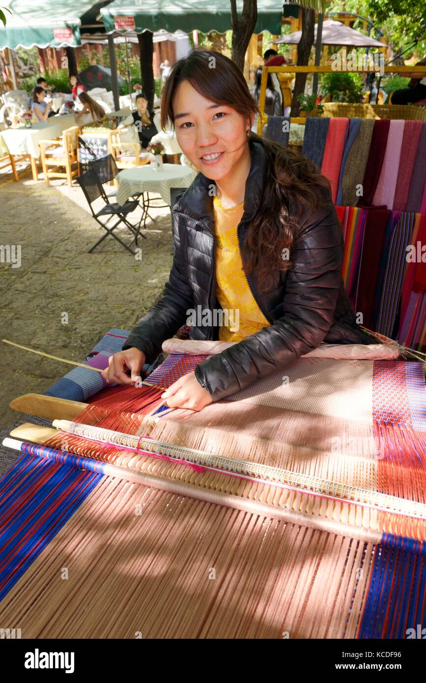 Shuhe Old Town World Heritage Site, Lijiang, Yunnan, China. Naxi ethnic people ancient culture site. Young woman - Stock Image