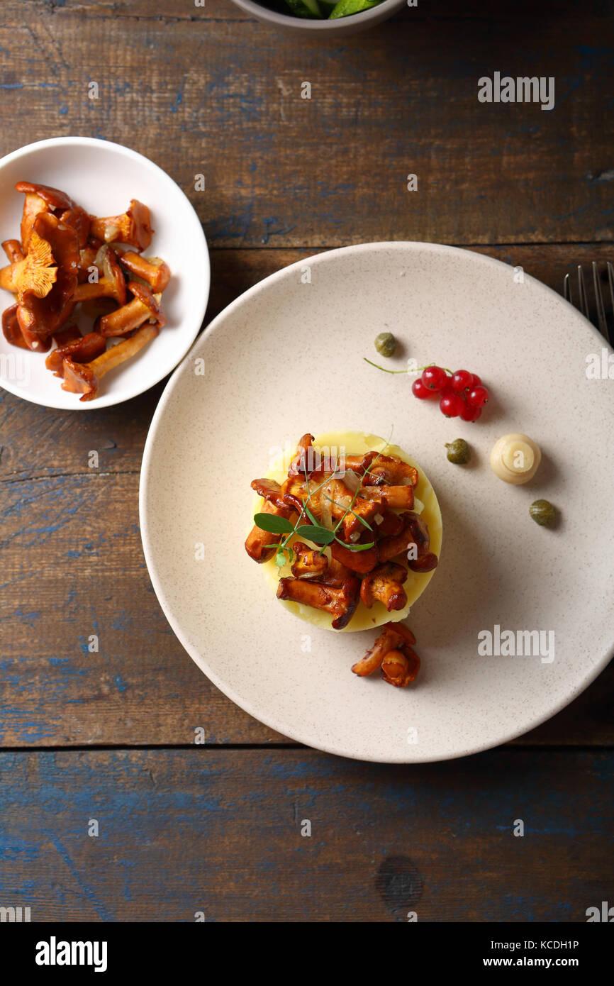 Homemade potato with mushrooms, food top view - Stock Image