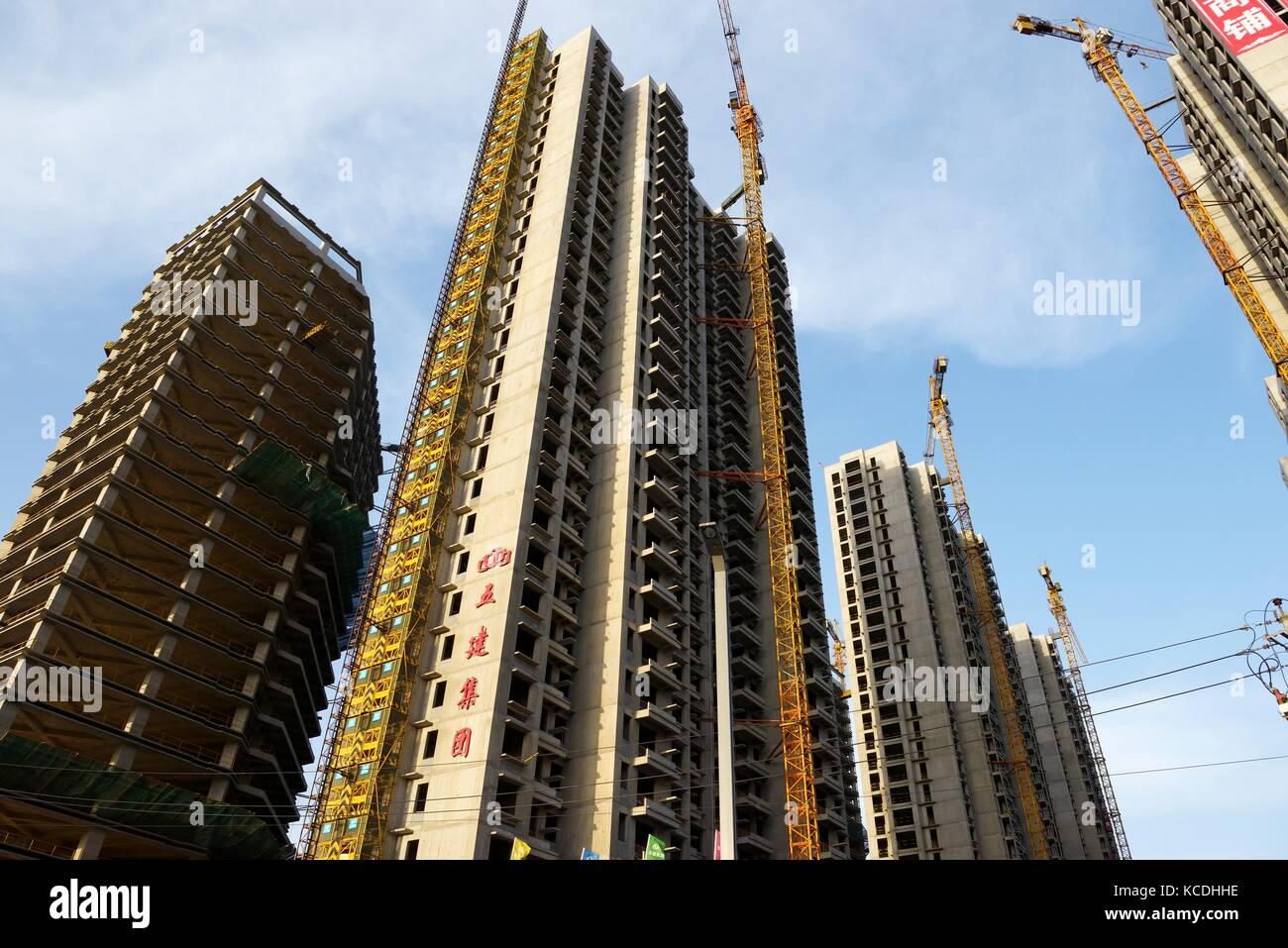 City of Taiyuan, Shanxi, China. New and under construction apartment blocks high rise accommodation, some are private Stock Photo